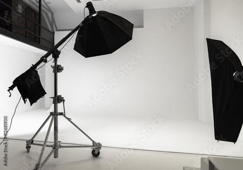 White photo studio interior background, impulse lights set © evannovostro