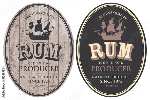 Papel de parede Set of two vector labels for Rum in oval frames with sailing ships and inscriptions on a wooden and black background in retro style