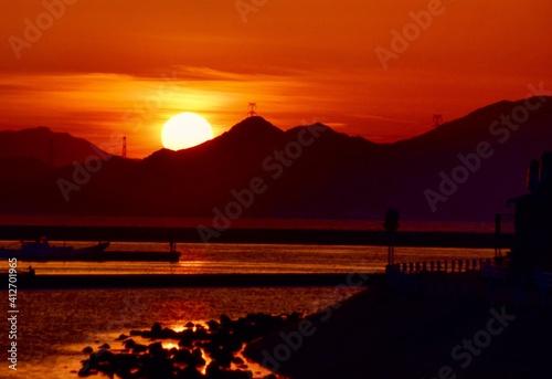 Fotografie, Obraz Silhouette Mountain By Sea Against Orange Sky