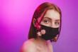 Leinwandbild Motiv Woman in trendy fashion outfit during quarantine