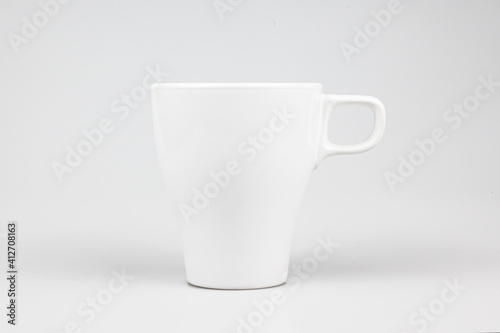 Closeup shot of a ceramic white mug isolated on the white background Fototapet