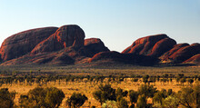 Red Mountains In The Afternoon Sunlight In  The Northern Territory Of Australia.