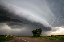 A Shelf Cloud Approaches Over A Highway In The Plains Preceding A Derecho.