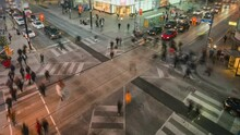 Toronto, Ontario, Canada, Zoom Out Time Lapse View Of Traffic And Pedestrians Crossing Busy Intersection At Yonge And Dundas Square.