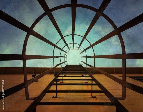 Fotografie, Obraz Directly Below Shot Of Fire Escape Ladder Against Sky