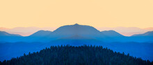 Abstract Mirror Effect Of Cascade Blue Mountains At The Morning - View Of Wilderness Mountains During Foggy Weather