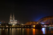 Beautiful city of Cologne gleaming under the night sky in Germany