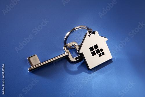 Fototapeta Close-up Of Key Ring On Blue Background obraz