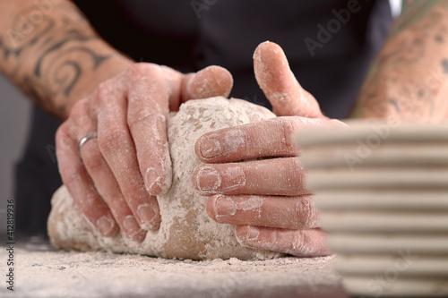 tattooed hands kneading rye sourdough Fototapet