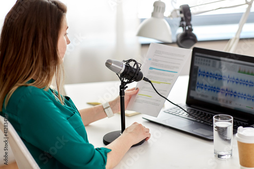 Fototapeta technology, mass media and people concept - close up of woman with microphone an