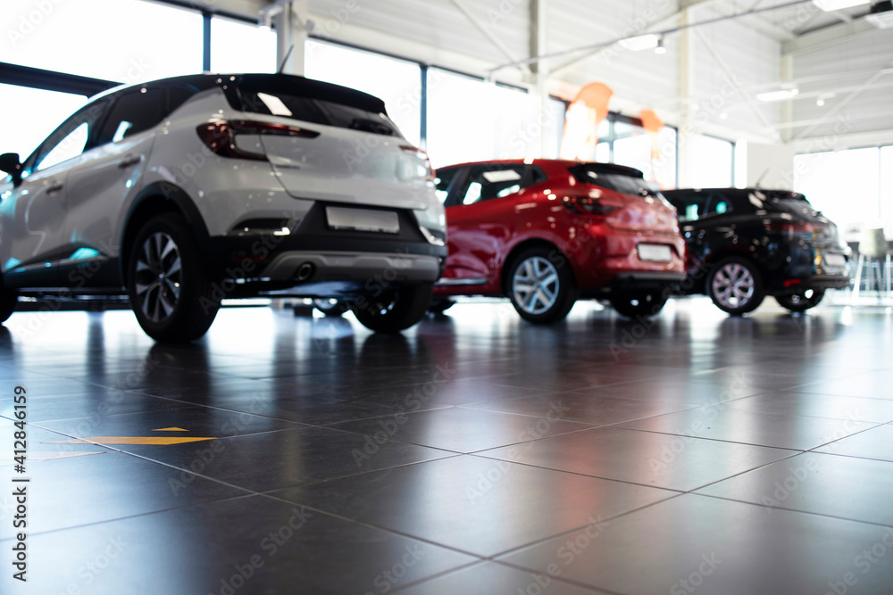 Fototapeta Car dealership showroom with vehicles for sale. Modern car purchase.