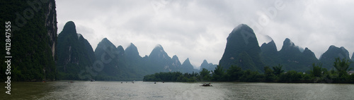 Fotografie, Obraz Panoramic View Of River And Mountains Against Sky