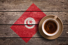 Directly Above Shot Of Coffee Served By National Flag Painted On Wooden Table
