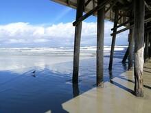 Scenic View Of Sea Beneath Daytona Pier Against Sky