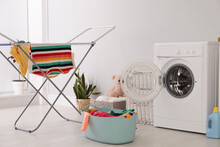 Clothes Drying Rack, Laundry Basket And Washing Machine Indoors