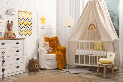 Fototapeta Stylish baby's room with comfortable cot. Interior design obraz