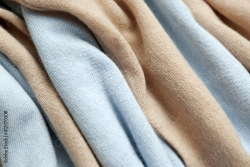 Different cashmere clothes as background, closeup view © New Africa