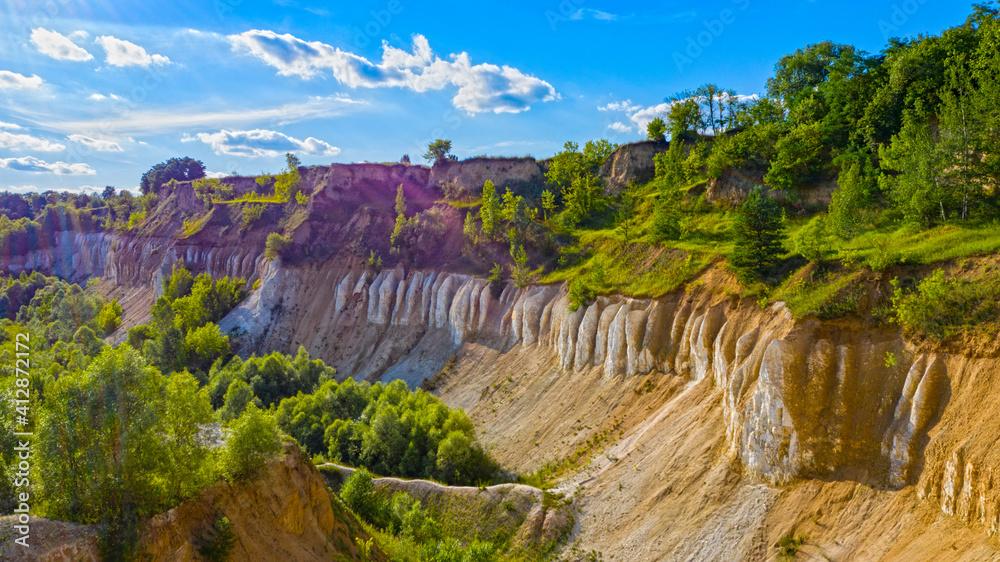 Fototapeta Beautiful summer landscape old chalk quarry. Nature landscape with old chalk quarry. Beautiful hilly.