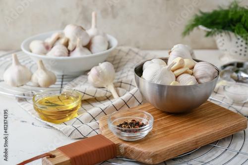 Fototapeta Bowls with fresh garlic on table obraz