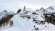 Idyllic Village On Top Of Hill In Winter. Ski Resort, Skiing, Tourism. Monte Lussari, Italy.