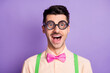 Photo of amazed funky funny nerd man wear glasses bowtie suspenders isolated on violet color background