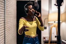 Black Singer Recording In Music Studio