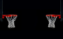 Basketball Hoops Against Black Background