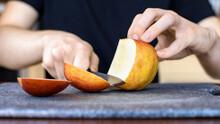 A Man Slicing Apple