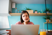 Portrait Young Stressed Displeased Worried Business Woman Sitting In Front Of Laptop
