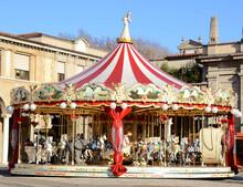 Merry Carousel For Children In The Center Of Bergamo