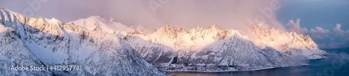 Obraz Panorama of snow mountain range with sunshine in the morning at Senja Island - fototapety do salonu