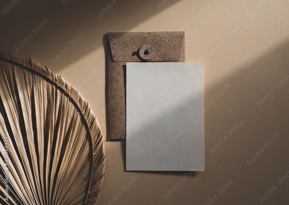 Fototapeta Blank uncoated paper card isolated on beige boho style background