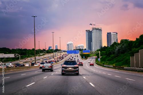 Fototapeta premium Cars On Road In City Against Sky