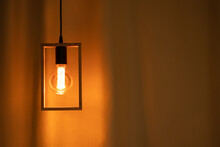 Included Electric Light Bulb On The Background Of Dark Curtains, Lamp