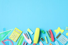 Different Stationery On Light Blue Background, Flat Lay With Space For Text. Back To School