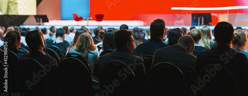 Leinwand Poster Rear View Of People Sitting In Auditorium During Seminar