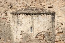 Peeling Plastered Stone Wall Of Orthodox Church Ekklisia Agios Ioannis With Small Window In Greece