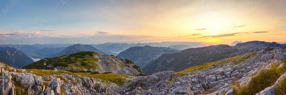Fototapeta Panoramic View Of Mountains Against Sky During Sunset