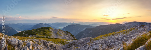 Fototapeta Panoramic View Of Mountains Against Sky During Sunset obraz