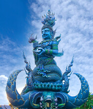 Blue Statue Of The Guard - Detail Of Exteror Of Wat Rong Suea Ten, Or Blue Temple In Chiang Rai, Thailand