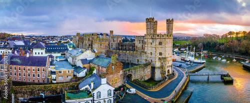 Fotografie, Tablou Aerial view of Caernarfon Castle, a medieval fortress in Caernarfon, Gwynedd, no