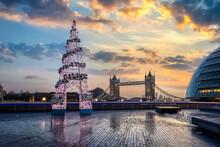 Illuminated Christmas Decoration Against Bridge And Sky During Sunset