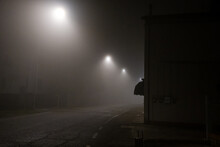 Empty Road Along Illuminated Street Light At Night