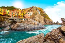 Manarola In Cinque Terre On The Mountain Near Mediterranean Sea In Liguria - Italy. Sunny Cloudy Sky. Traditional Italian Architecture