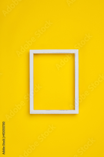 Close-up Of Blank Picture Frame On Yellow Wall Poster Mural XXL