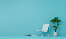 Beach Chair Potted Plant On Table Against Blue Wall