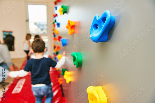 Obraz na plátně Wall with climbing grips in daycare or kindergarten, activity for little childre