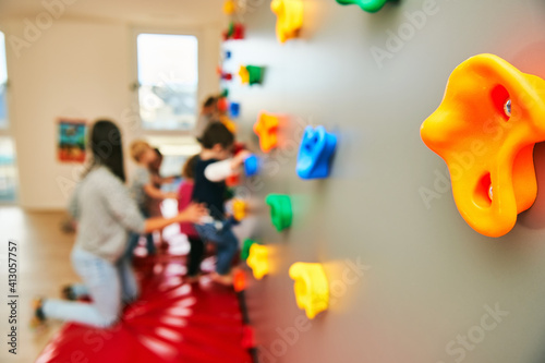 Fotografie, Obraz Wall with climbing grips in daycare or kindergarten, activity for little childre