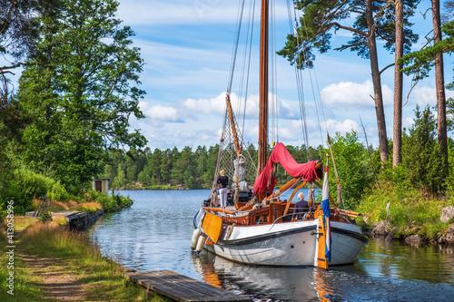 Fototapeta Beautiful Wooden Sailboat On Göta Canal In Sweden A Summer Day obraz