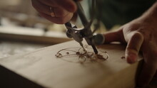Unrecognized Man Carving Ornament Indoors. Man Hands Making Decor In Studio